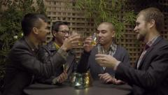Group Of Gay Couples Toast In Celebration, At An Outdoor Restaurant Or Bar (4K) Stock Footage