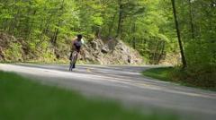 Male Cyclist Enjoying the sun in Gatnieau Hills Stock Footage