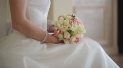 Hands of the bride and groom with rings on a beautiful wedding bouquet Stock Footage