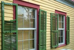 Colored shutters on window of plantation house Louisiana Southern USA Stock Photos