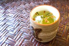 Cup of green tea on wooden table Stock Photos
