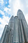 KUALA LUMPUR, MALAYSIA - FEB10, 2015: Cloudscape view of the Petronas Twin To Stock Photos