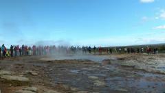 Tourists Watch as Strokkur Geyser Erupts, ICELAND  Stock Footage
