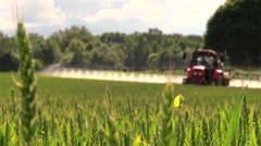 Farmer with tractor spray fertilize field with chemicals Stock Footage