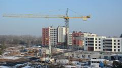 Crane lift block. Flat house apartment construction site works Stock Footage
