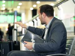Young businessman finishing work on laptop, leaving train station in hurry NTSC Stock Footage