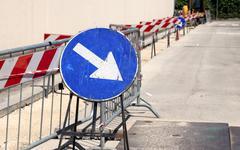 big road signal with arrow on the excavation during the roadworks - stock photo