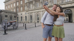Stockholm tourists selfie photo by Royal Palace Stock Footage