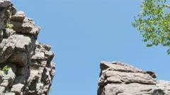 3561 Split Rock Cliff Blue Sky Forest, 4K Stock Footage