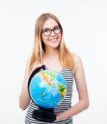 Stock Photo of Young girl in glasses holding world globe