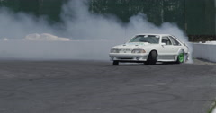 Race cars drifting on a track at a motorsport park Stock Footage