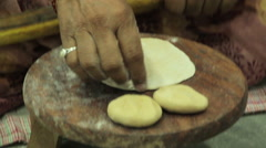 Indian women rolled chapatti Stock Footage