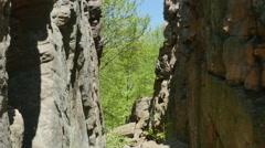 3562 Split Rock Cliff Blue Sky Forest, 4K Stock Footage
