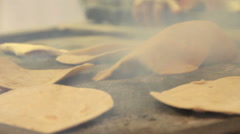 Indian chapatti fried on a hot plate Stock Footage
