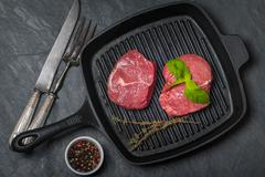 Raw fresh beef Steak on grill pan Stock Photos