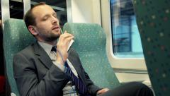 Stock Video Footage of Young businessman listening to music on cellphone sitting in train  HD