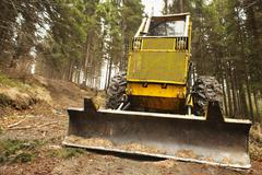 Stock Photo of bulldozer in forest