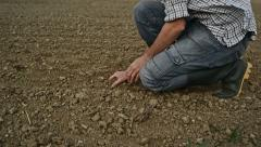 Farmer Checking the Quality of Fertile Soil Ground with Hands Stock Footage