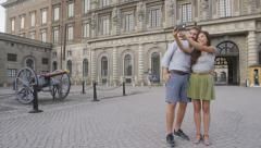 Tourists selfie photo by Stockholm Royal Palace Stock Footage