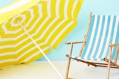 Sunshade and deckchair for summer Stock Photos