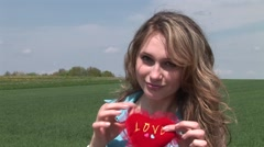 Girl playing with red heart Stock Footage