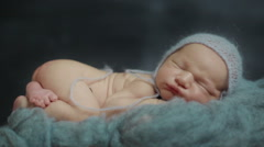 Close up of beautiful little newborn baby sleeping breathing and making faces Stock Footage