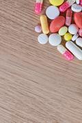 Multicoloured pills and capsules Stock Photos