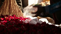 Ice cubes thrown on pile of flowers prepared to be tied in a sack. Stock Footage