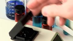 Removing test tube of red liquid Stock Footage