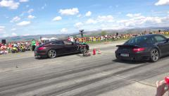 Drag race challenge cars burning tires on race track Stock Footage