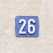 house number twenty six, white numerals on a blue background - 26 - stock photo