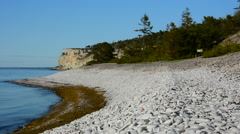 Stock Video Footage of Eroded limestone coastline on the island of Gotland in Sweden springtime