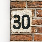 Hand painted house number thirty - 30 - stock photo