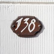 Hand painted house number one hundred and thirty eight. - 138 Stock Photos