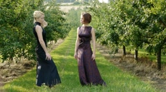 two beautiful girls in the garden selective focus - stock footage