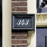 house number three hundred and forty three, in a picture frame. (343) - stock photo