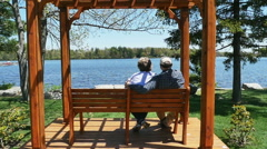 3573 Retired Couple Looking at Lake on Mountain Top in Slow Motion Stock Footage