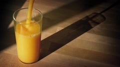 Orange Juice Poured Into Glass With Shadow Stock Footage