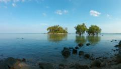 Pretty Little Tropical Island Viewed from a Shady, Deserted Beach Stock Footage