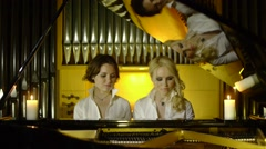 Happy Girls In White Blose Playing On The Piano - stock footage