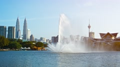 Fountain Spraying Skyward in a City Park Stock Footage