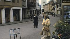 Cortina d'Ampezzo, Italy 1977: people walking in the street Stock Footage
