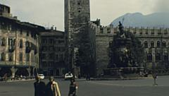 Trento 1977: people walking in the central square Stock Footage