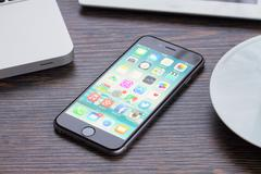 iphone 6 on working table - stock photo