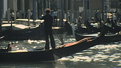 Venice 1977: gondoliere in the Grand Canal Stock Footage
