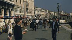 Venice 1977: people walking in Riva degli Schiavoni Stock Footage