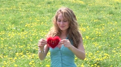 Pretty babe flirting with red heart Stock Footage