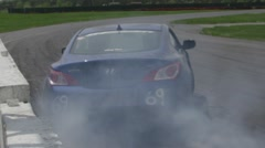 Race cars drifting on a track at a motorsport park - stock footage