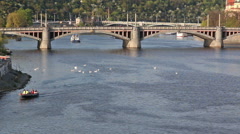 Boats arriving under the city bridge Stock Footage