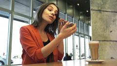 Stock Video Footage of Pretty woman applying mascara eyelash sitting in cafe HD
